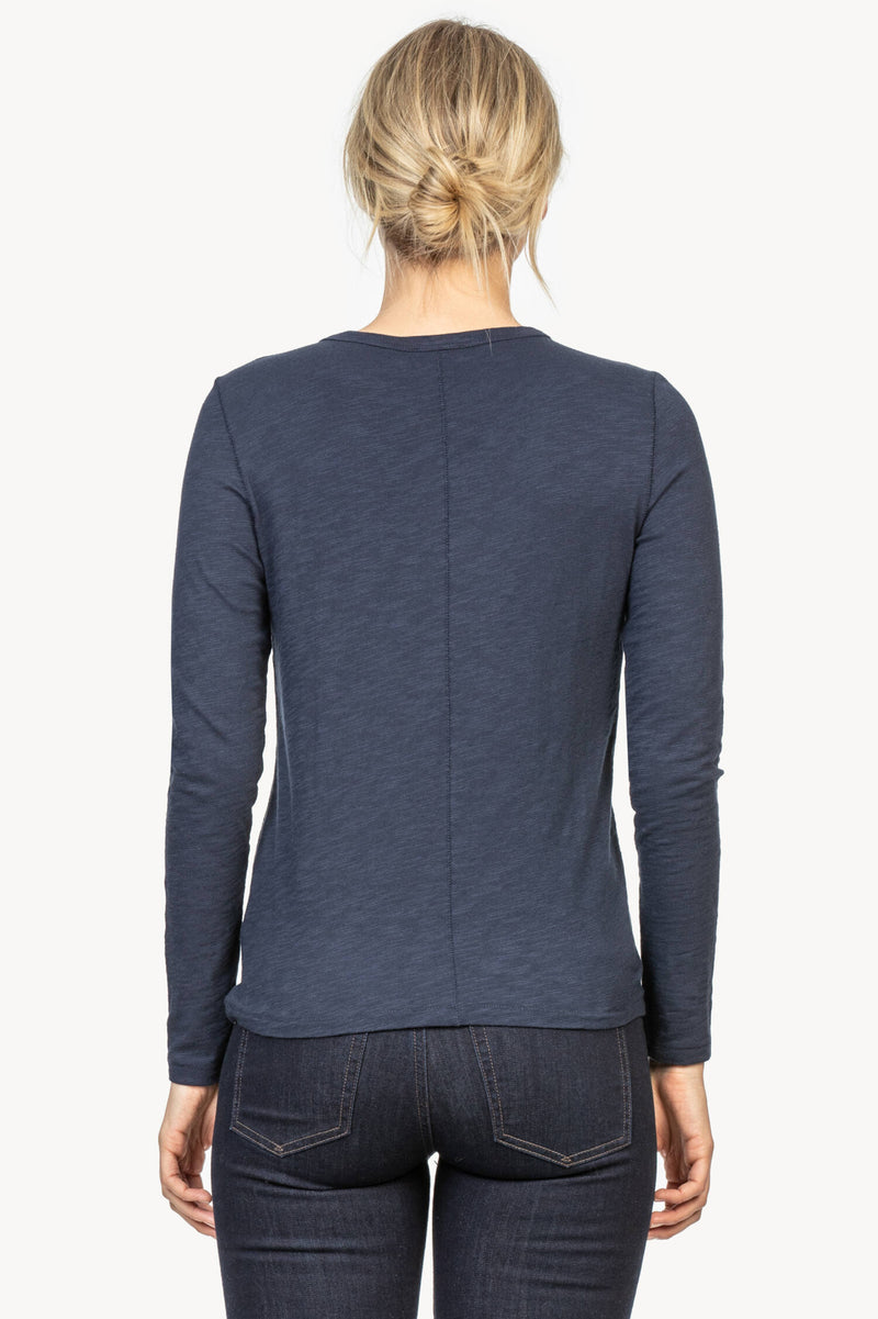 A back view of the Lilla P. long sleeve crew neck tee in the color Midnight.