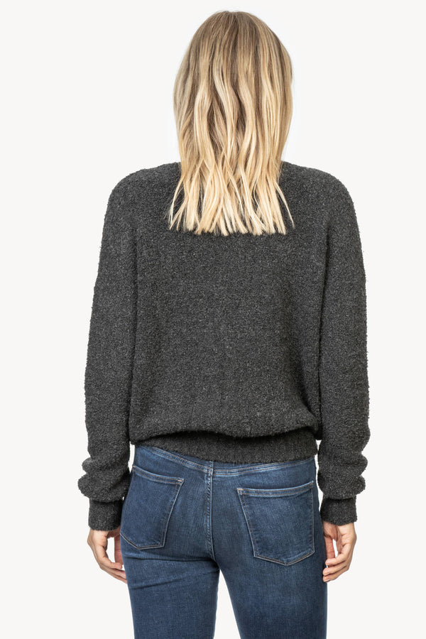 Back of sweater on model.