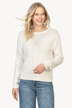 A front view of the Lilla P Mixed stitch sweater in the color Ivory. This sweater features cable knit stitching, rib knit, mesh knit, and tuck knit.