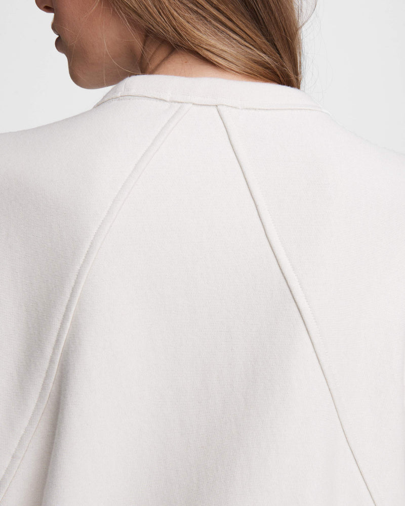 Close up of back seam on sweatshirt.