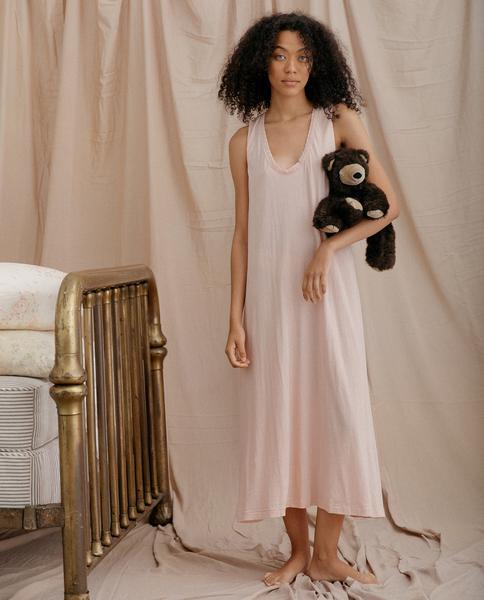 Front of dress on model holding a teddy bear.