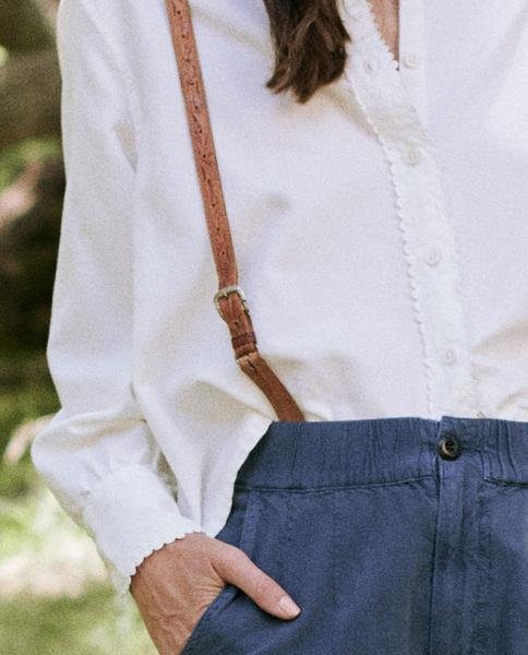 Close-up photo of blouse on model to show rick-rack details.