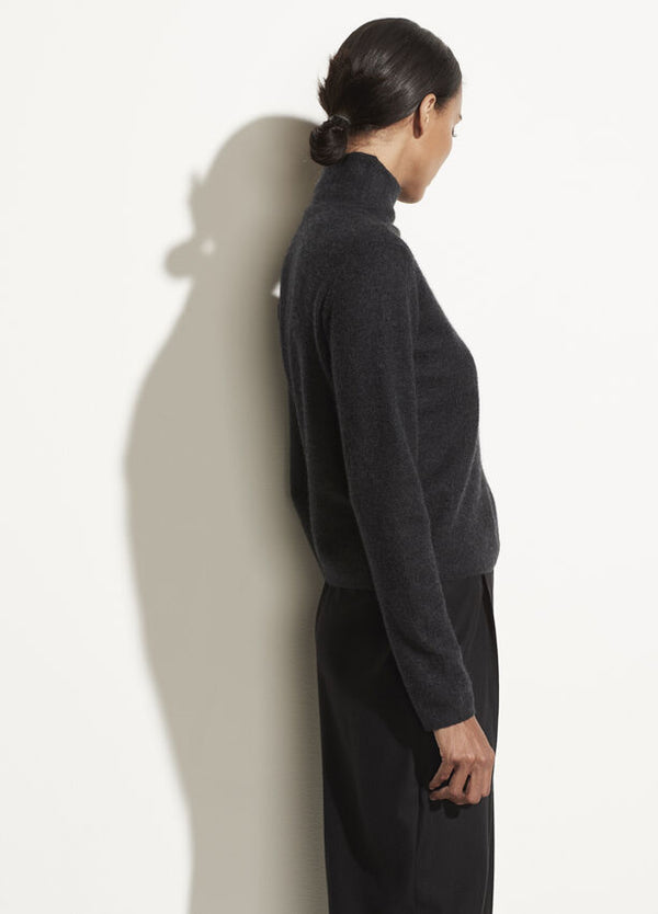 Side of sweater on model.