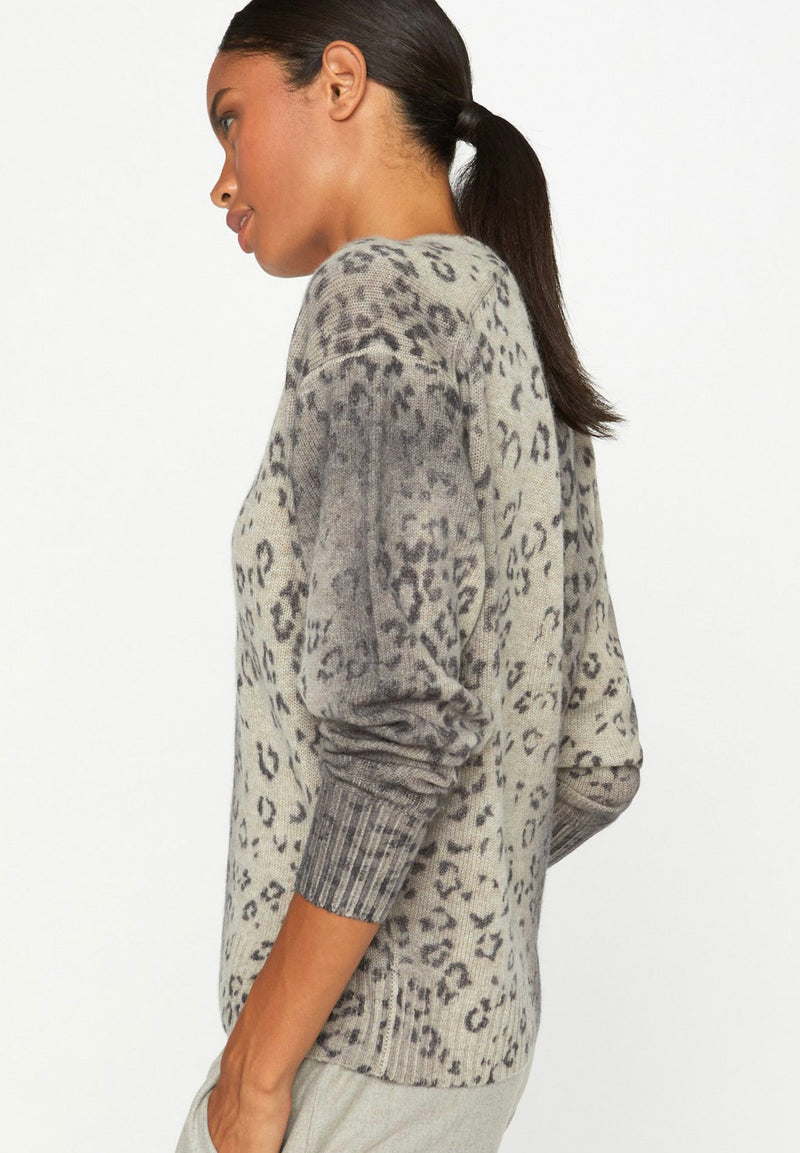 Sleeve and side of sweater on model.