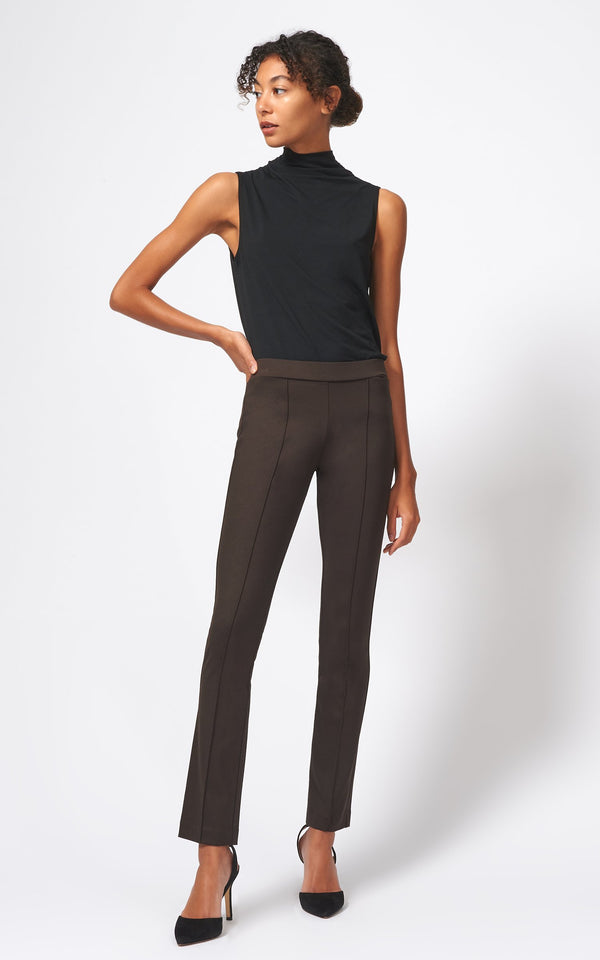 Front of pants on model wearing a black tank and heels.