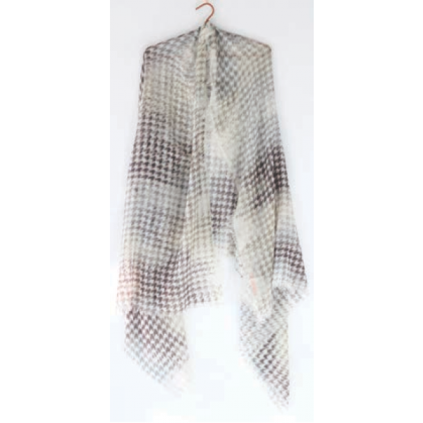 A view of the Ama Pure PDP scarf in grey and white houndstooth draped over a hanger.
