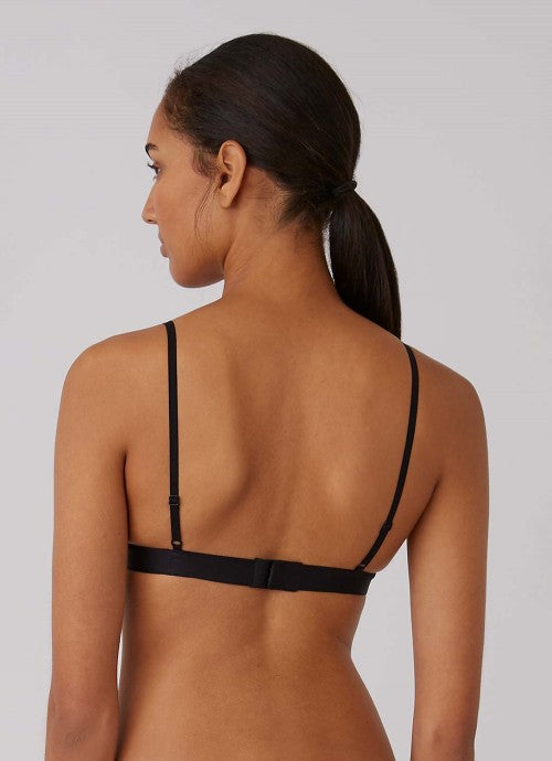 Back of black bra on model.