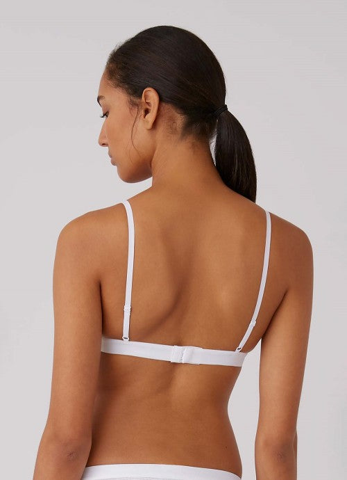 Back of white bra on model.