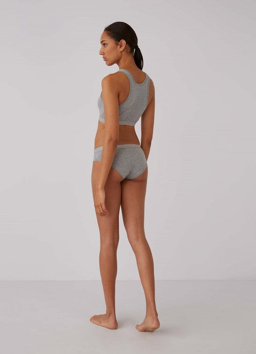 Back of grey underwear on model paired with matching grey crop top.