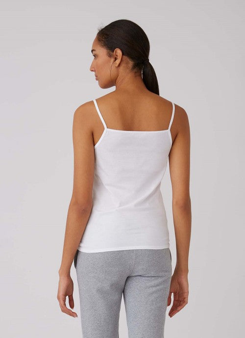 Back of white cami on model wearing grey pants.