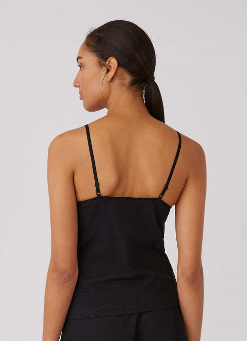 Back of black cami on model to show adjustable straps.