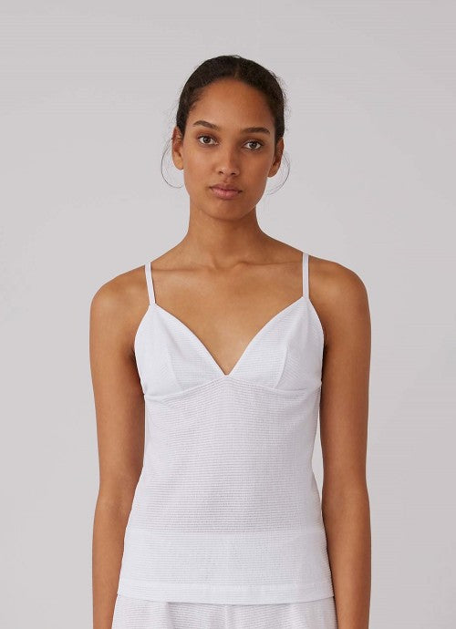 Front of white cami on model.