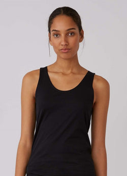 Front of black tank top on model.