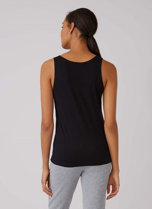 Back of black tank on model also wearing grey pants.