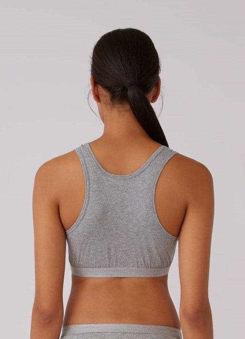 Back of grey crop top on model, photo cropped at model's waist.