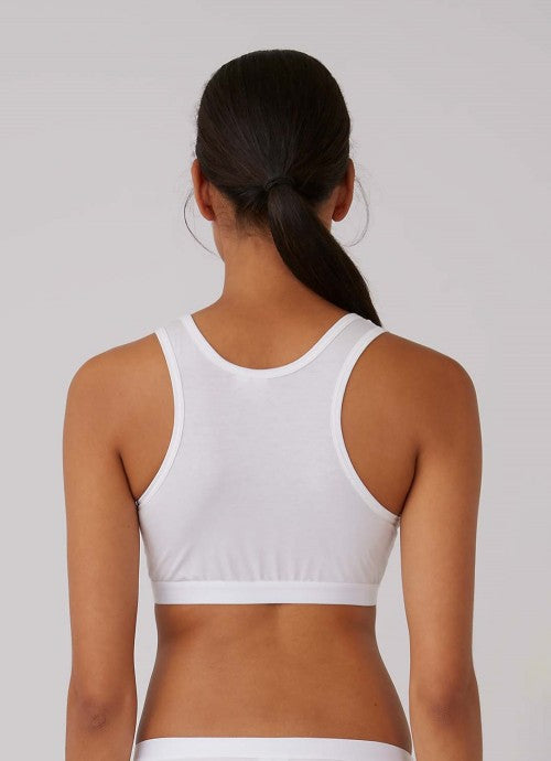 Back of white crop top on a model.