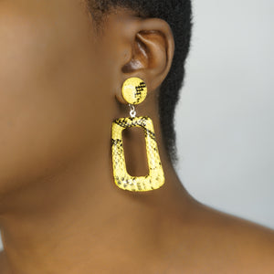 HEMA yellow snakeprint drop earrings