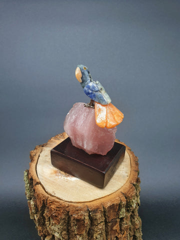 Pequeno Calcite Parrot mounted on Rose Quartz base