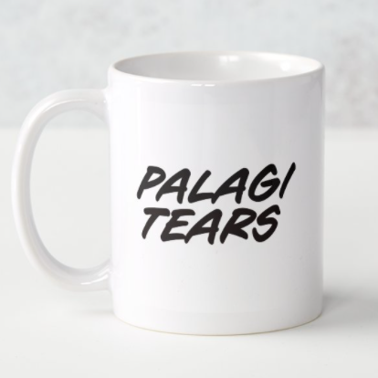 White mug with the words Palagi Tears printed in black.