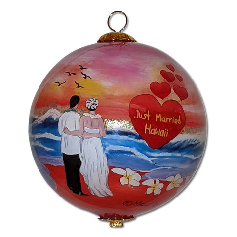 Hawaiian ornament with newly married couple and plumeria flowers