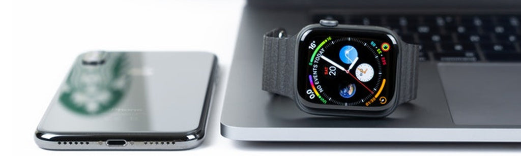 Apple Watch Series 4 with a computer and iPhone
