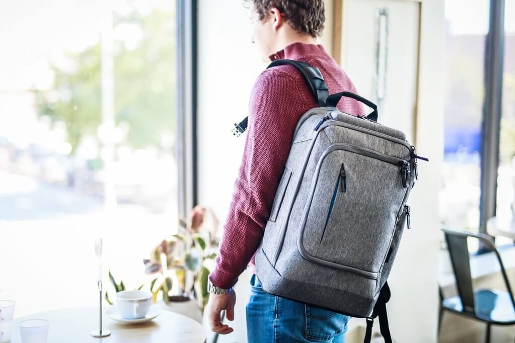 Man walking with a Targus CityLite laptop backpack