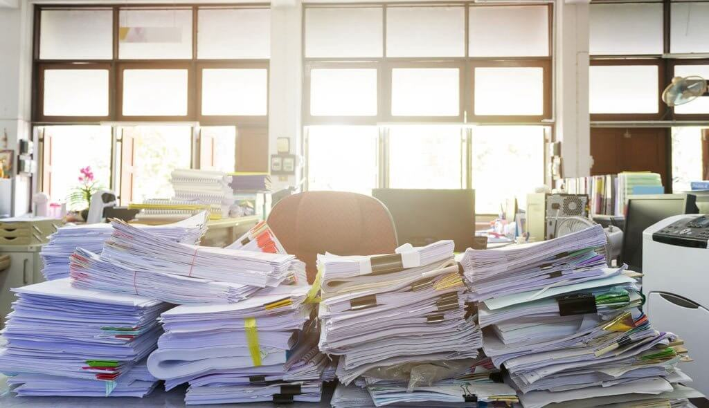 Desk piled with papers