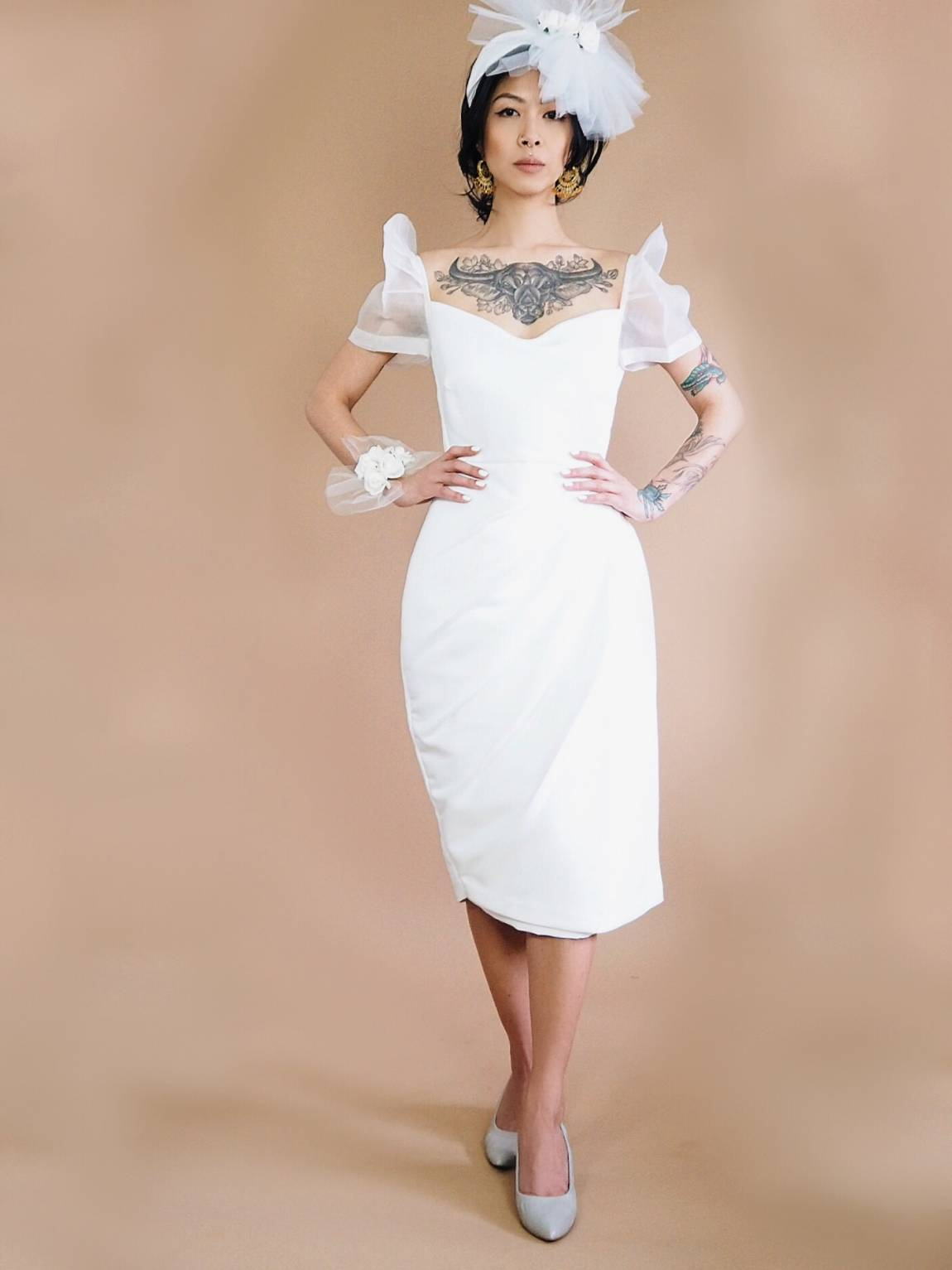 VINTA Drape Front Terno, white, styled with corsage, fascinator, and grey pumps