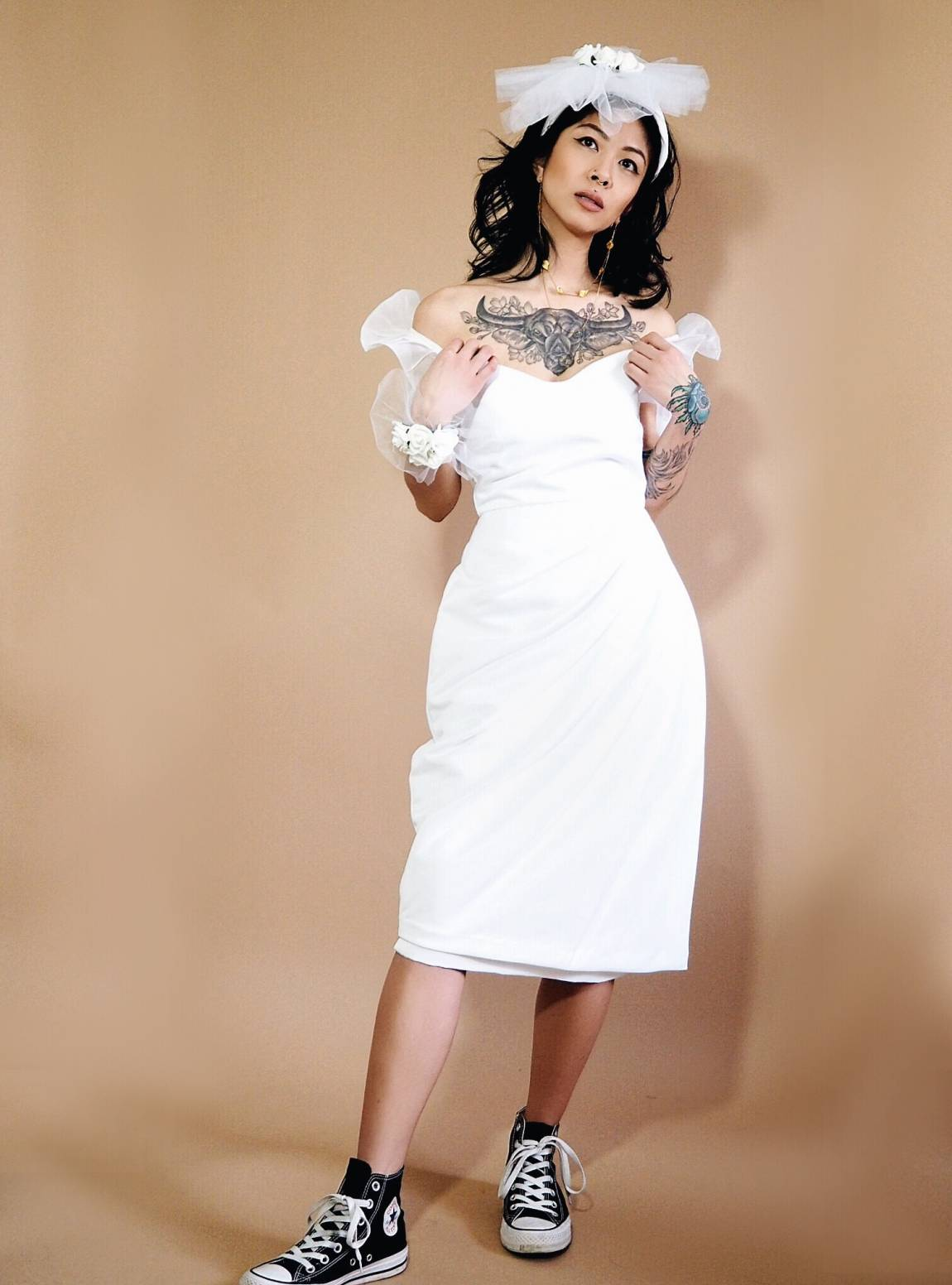 VINTA Drape Front Terno, white, styled with corsage, fascinator, and Converse shoes