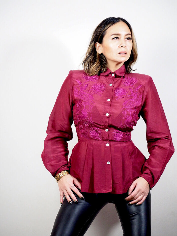 VINTA Peplum Barong in burgundy, with vibrant burgundy thread embroidery. Top is styled with black, liquid leggings.