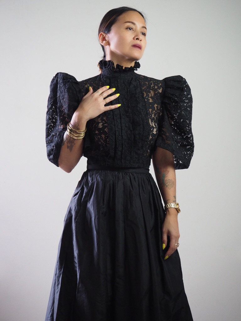 VINTA High Neck Pleat Front Camisa in Black, Styled with High Waisted Black Skirt
