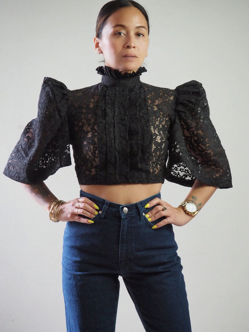 VINTA High Neck Pleat Front Camisa in Black, Styled with High Waisted Dark Denim Jeans, Models Hands on Hips