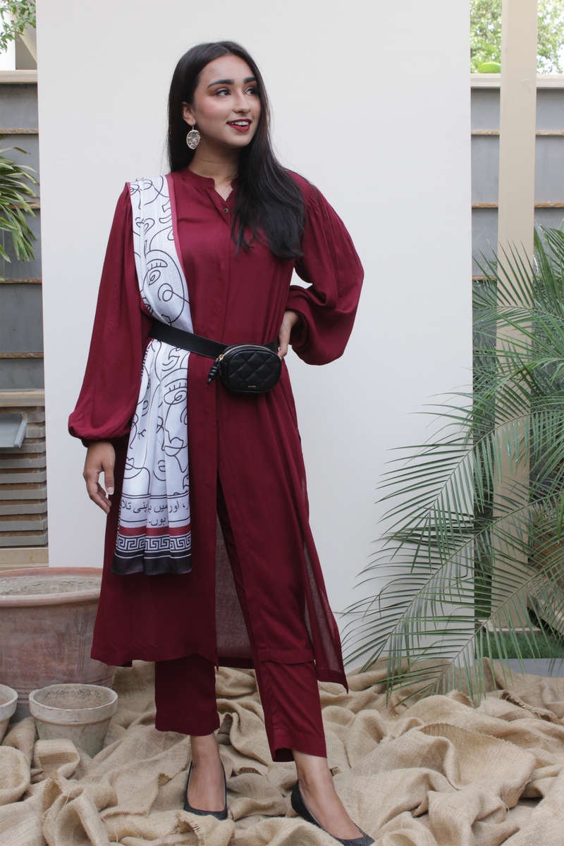 Maroon Ruby Lilen, 2 piece set from our Manto Aura Collection. It is a long, front-open kameez/ kurta with long balloon sleeves and trousers/ pajama pant
