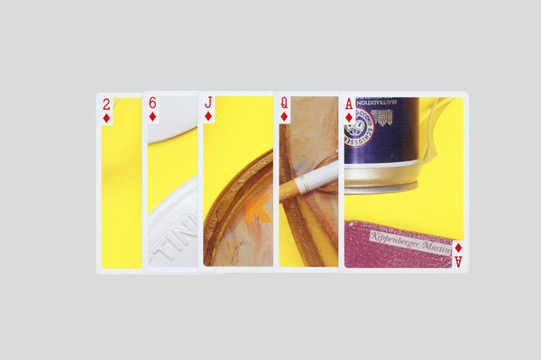 A collection of nine Kippenberger editions, ~one Boetti watch, a cigarette and yellow