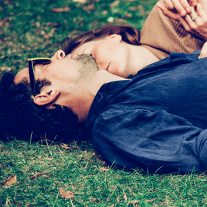 couples lying on grass