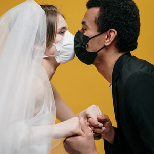 Couples kissing with n95 mask on
