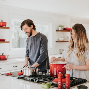 couples in a kitchen cooking