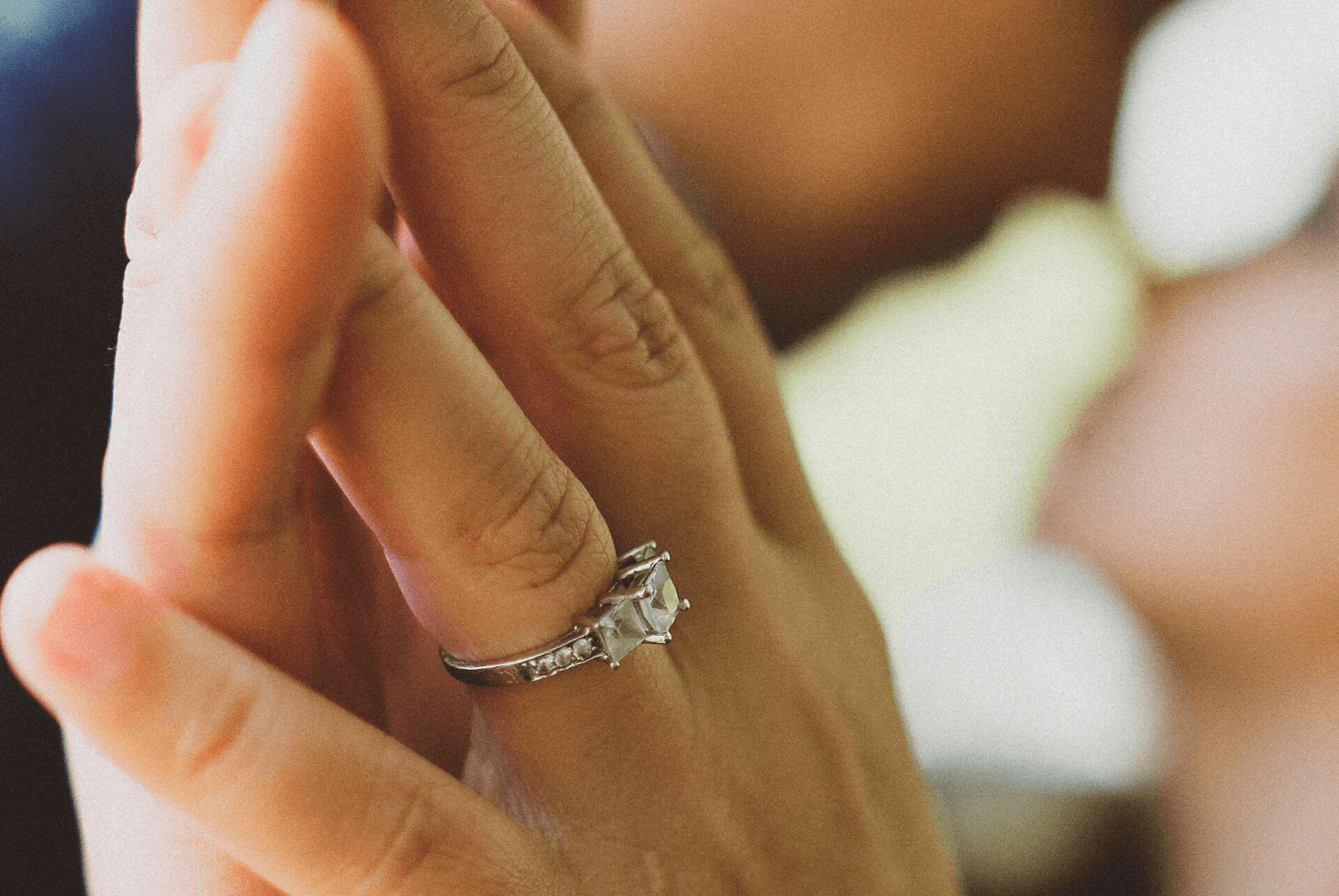 close-up photo of wedding ring on finger