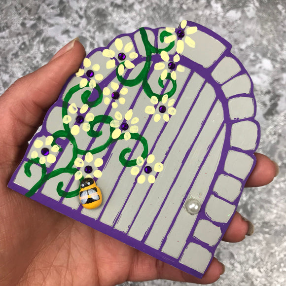Floral fairy door with bee