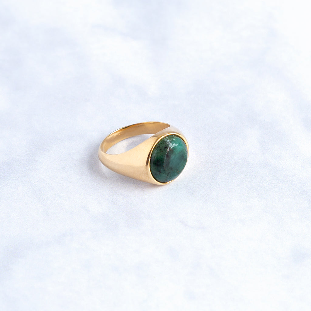 signet round in gold vermeil with an emerald