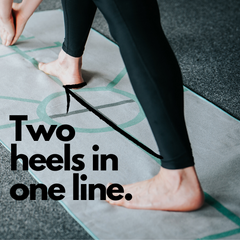 standing separate leg head to knee pose from the bikram hot yoga postures using the archer hot yoga towel the best hot yoga towel to align foot placement.