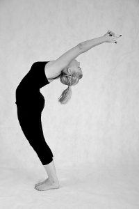 back bend in half moon pose in bikram or hot yoga