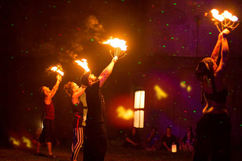 Fire dancers at city of night