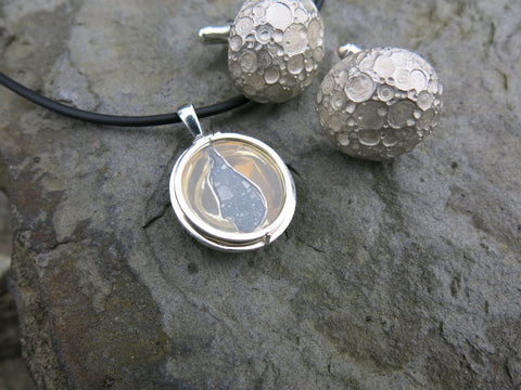 "<p>sarah's  Lunar Feldspathic Breccia ""moon"" locket in sterling silver with gold plate and lunar cufflinks in sterling silver</p>"