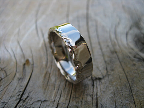 ian's wedding ring: a simple 14k palladium white gold band that both matches Tanya's set but acknowledges Ian's minimalist aesthetic