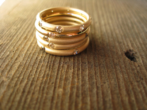andrea stacking rings: 14k heirloom yellow gold with heirloom diamonds 4 sandblasted and one high polished.