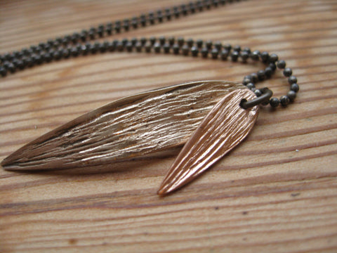 <p>rose necklace: rose gold, bronze bamboo leaf necklace on antiqued silver chain</p>
