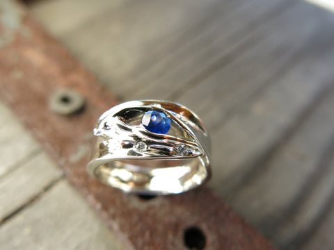<p>candace lily leaf ring: 10k heirloom white gold and diamonds set with a blue sapphire</p>