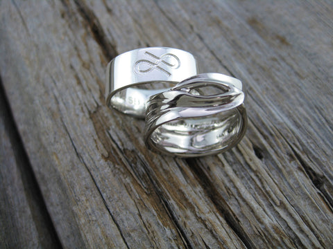 alison and stewart rings: hers a 14k palladium white gold lily leaf ring and his a simple silver band with personal design element - both engraved