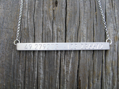 kirsten coordinates necklace: sterling silver hand constructed, engraved with specific coordinates.